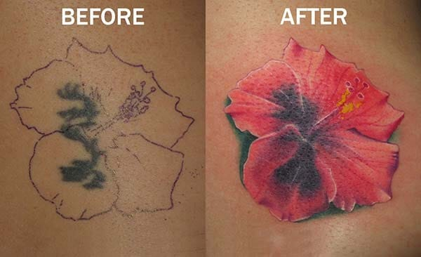 A cover up tattoo of a Hibiscus flower.