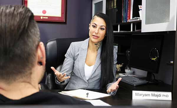 Dr. Maryam Majdi PhD performing a consultation in her office at Azalea Laser Clinic.