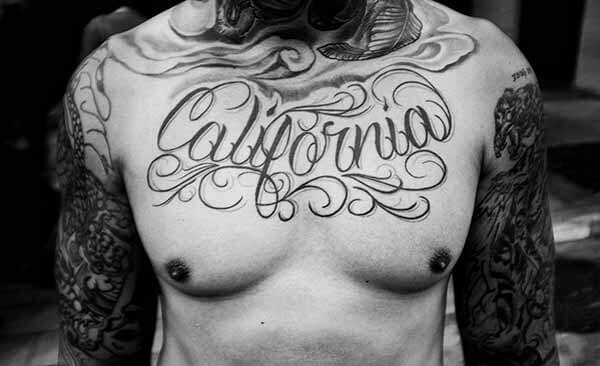A chest tattoo of the word California.